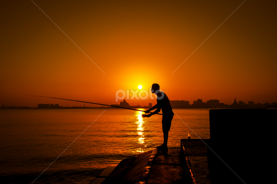 The Fisherman by Jun Ong - Landscapes Sunsets & Sunrises ( silhouette,  )