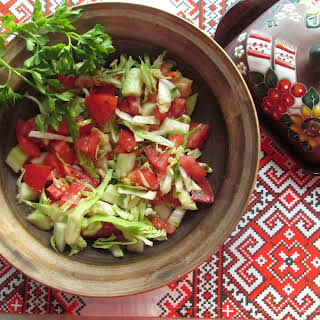 Cabbage, Cucumber, And Tomato Salad Dressed With Olive Oil.
