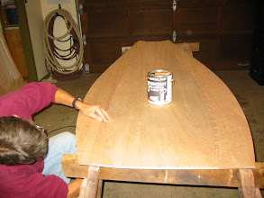 Photo: Stitching first plank on port side.