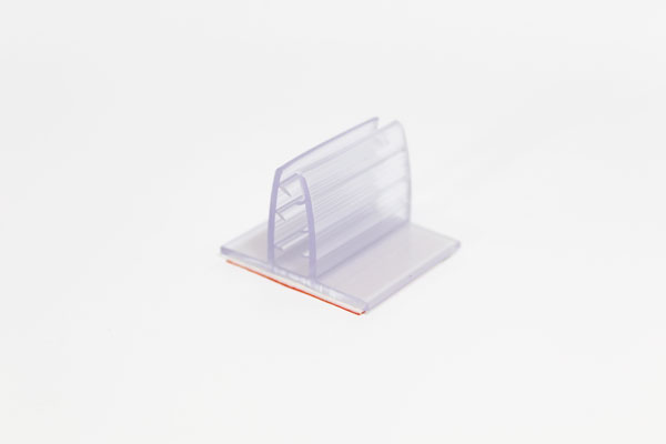 pinza plástica sujeta gráficas de 3,5 x 3 cm con adhesivo espumoso