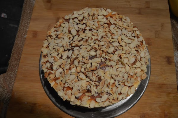Brush the top of cake with a little additional amaretto the sprinkle on all...