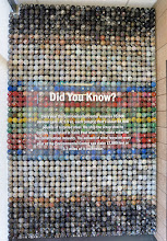 Photo: This display is made of aersol paint cans which have been emptied, then retrieved from the recycling stream for this display.