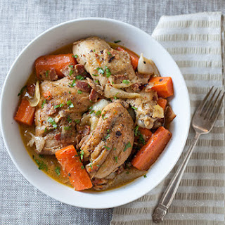 Wine-Braised Chicken with Bacon, Veggies and Herbs.