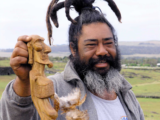 A craftsman sells his wares on Easter Island.