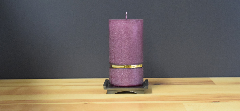Texturized purple pillar candle