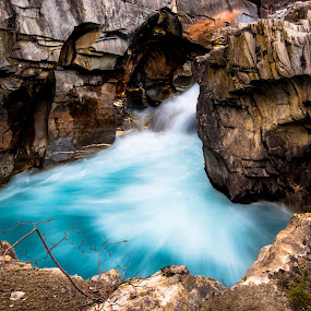 Rushing water between the rocks by Penny Miller - Landscapes Waterscapes ( water, cyan, turquoise, alpine waterfall, blue, slit canyon, waterfall, canyon, rock, aqua, rocks )
