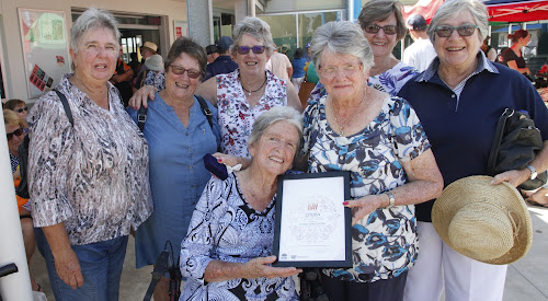 Family and friends congratulate Citizen of the Year Dawn Armstrong, from left, Eva Sadler, Helen Woodward, Lyn Wedesweiler, Rhonda Welchman, Val Faulkiner, front seated, Dawn' Armstrong's sister Phyllis Drysdale and Citizen of the Year Dawn Armstrong.