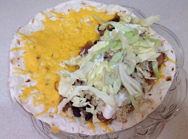 Add dollops of the yogurt like you would sour cream, then sprinkle with shredded...