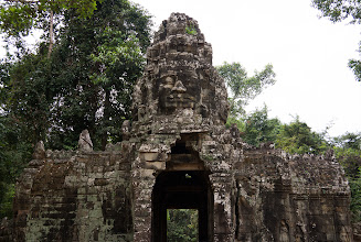 Photo: Bicycles made it easy to explore the smaller outlying temples, which I found more suggestive than Angkor Wat. This is the entrance to Banteay Kdei, watched over by an imposing four-headed Buddha.