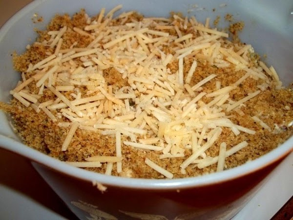 Spoon into prepared dish. Top with remaining crumbs, sprinkle with remaining Parmesan cheese and...