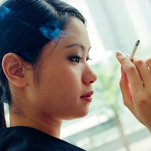 Photo: Woman Smoking a Cigarette --- Image by © Jack Hollingsworth/CORBIS