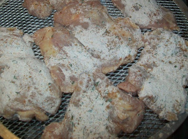 Dredge the chicken in the flour, and set aside on a rack to air...