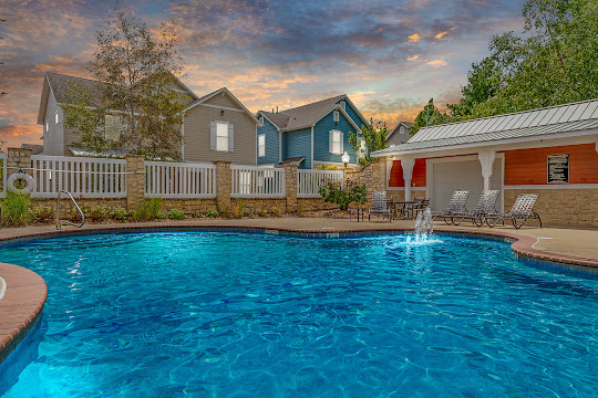 Hutton Farms Apartments & Townhomes sparkling swimming pool at dusk