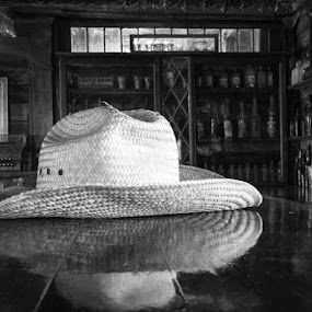 A hat on the bar by Alan Cline - Black & White Objects & Still Life ( western, bar, drinks, hat )