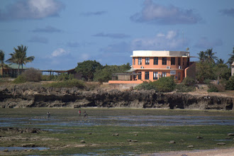 Photo: Part of the recent building in Pemba overlooking kids gleaning on the reef flat