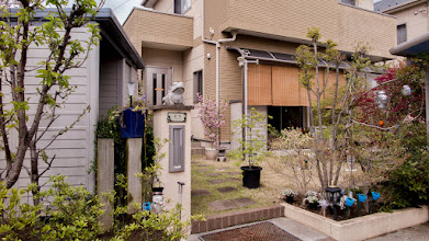 Photo: A warm, welcoming, and beautifully tended house front and garden featuring stone frogs. Read more about Oizumi: http://japanvisitor.blogspot.jp/2015/04/oizumibrazil-in-japan.html