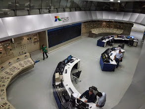 Photo: Control room at Itaipu Dam - half in Brazil, half in Paraguay; notice the cleaning lady