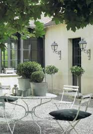 Classic Courtyard with French bistro style white garden furniture and  simple clean styling. Elega… | Courtyard gardens design, Outdoor dining  room, French courtyard