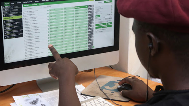 A man analyses the odds at a popular betting site