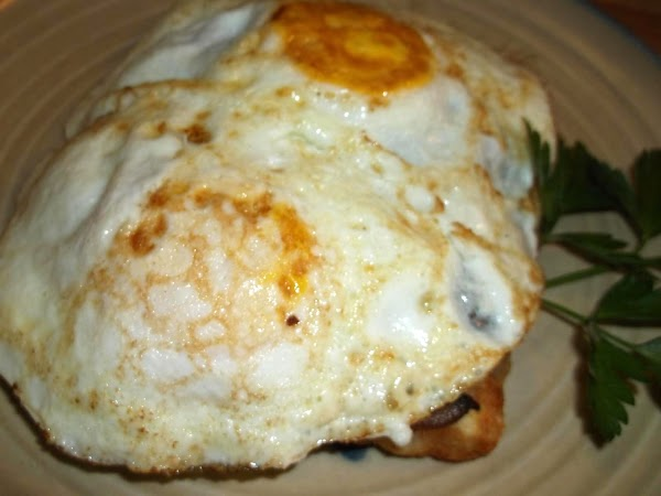 Remove prepared hash brown patties from oven to serving plate; slide eggs from skillet...
