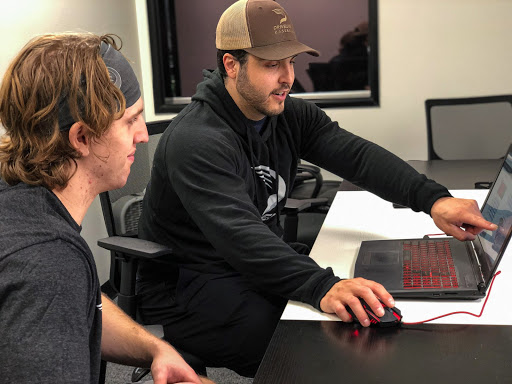 Trainers meet with athletes one-on-one to discuss collected data during hitting assessments