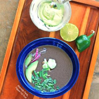 Slow-Cooker Black Bean Soup with Avocado Crema.