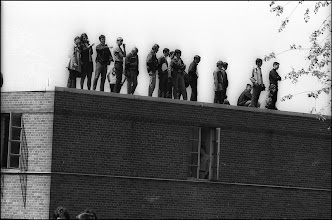 Photo: Students watching the activities from the top of Johnson Hall, a men's dorm.