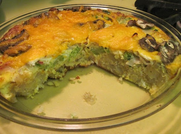 Take a glass pie plate and outside crust of hashed brown potatoes, pressed into...