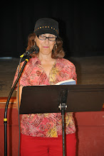 "Photo: Ann Teplick reads her poem ""Ritual."""
