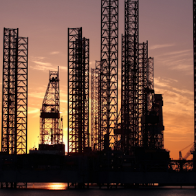 Oilrigs in Esbjerg Harbour by Per Holt Oksen-Larsen - Landscapes Sunsets & Sunrises ( water, sunset, harbour )