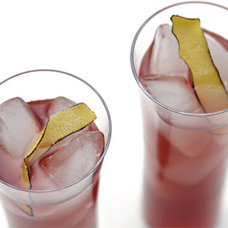 Blackcurrant Cocktail With Coconut Water And Burnt Lemon Peel.
