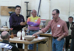 Photo: Pat Taylor with his ambrosia maple bowl. David Jacobowitz, Clif Poodry, Mike Vore, and Richard Webster look on.