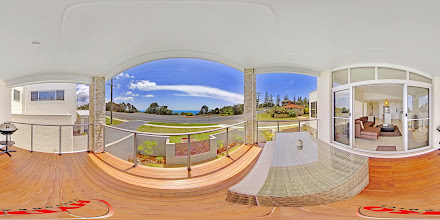 Photo: Beach House 1 - Upstairs View from balcony looking across towards Nobbys Beach www.escapeatnobbys.com.au