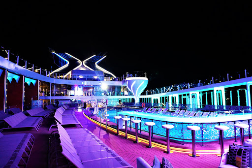 The Resort Deck on Celebrity Edge gets dolled up with rich neon colors at night.