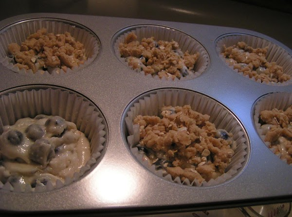 Fill muffin tins 3/4 full and add crumb topping or sprinkle with sugar if...