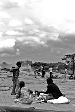 Photo: Families visit this large park in Bangalore and sit out across the rock plateau.