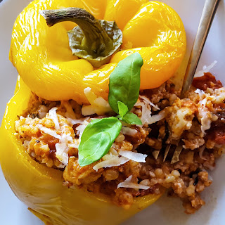 Easy Stuffed Bell Peppers with Brown Rice & Creamy Tomato Sauce.