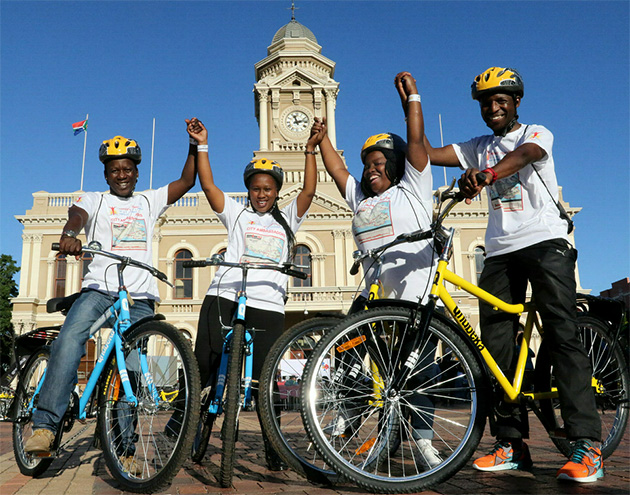 Luxolo Bell, 32, Ntombizanele Myoli, 25, Nokuthula Modi, 28, and Hanson Singaphi, 41, are ready to ride after receiving their bikes at yesterday's handover