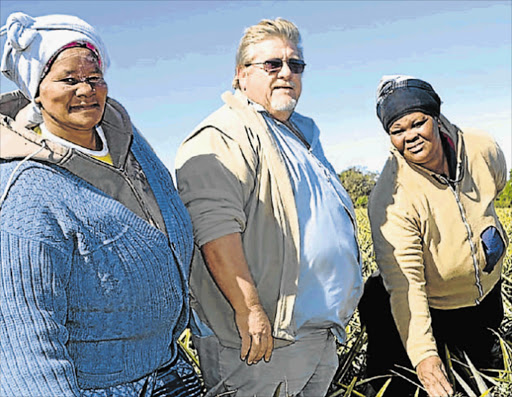VIABLE: Linda Abrahams, left, and Ntombekhaya Vulindlu are beneficiaries of a thriving 50/50 redistribution project at Bathurst, with Birbury farm manager Bruce Thompson