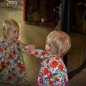 Toddler at fairground mirror by Craig Payne - Babies & Children Hands & Feet ( mirror, hands, fairground, toddler, flowers )