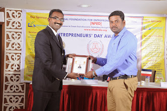 Photo: Guest of Honour Mr. Bobby A. Mathew Issuing Young Entrepreneur Award to Mr. Sam Peter, Founder & Managing Director, Softwings Techologies, Coimbatore