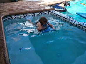 Photo: Finn Learns to Kick Board