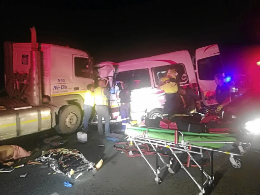 Medical personnel attend to the accident scene that claimed 15 lives on the N4 between Malelane and Mbombela on Friday. A head-on collision claimed the lives of six people on the N1 in Modimolle.