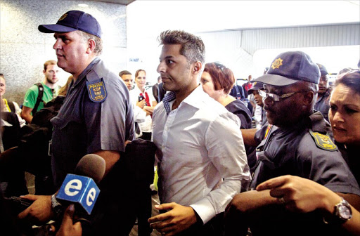 Shrien Dewani at Cape Town International Airport for his flight to Dubai en route to his home in the UK. Judge Jeanette Traverso dismissed the case against Dewani, who was accused of masterminding the murder of his wife, Anni, on their 2010 honeymoon