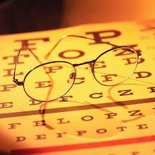 Photo: Glasses on Eye Chart