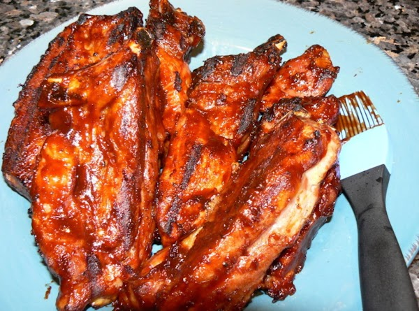 Start the grill. Remove ribs out of pan (they should be almost, fall off the...