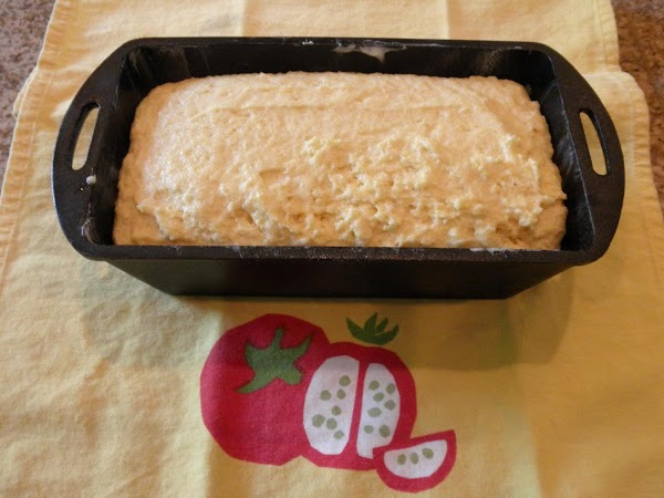 Working quickly, scrape the batter into a well greased loaf pan. Smooth the top...