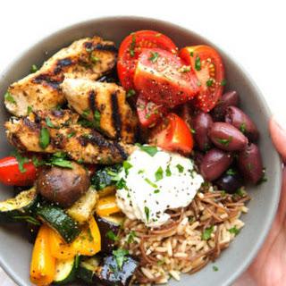 Greek Chicken Souvlaki Bowls with Roasted Veggies and Tzatziki Sauce.