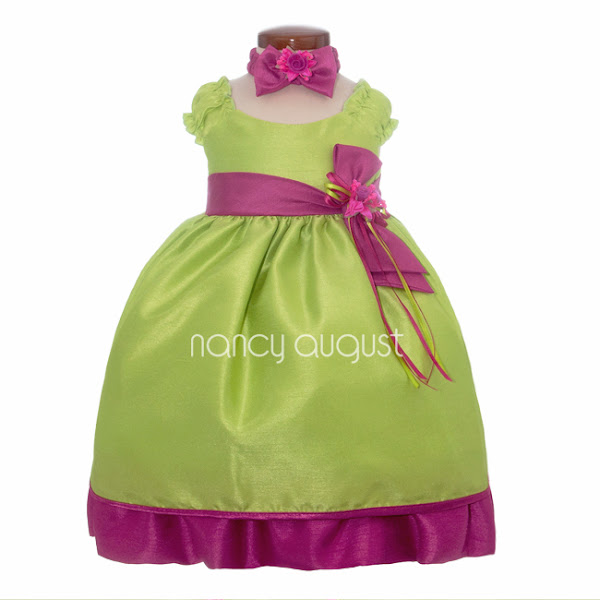 Photo: Springtime Lime Lemonade Baby Dress: his lime lemonade baby dress is just the one you were looking for! The classic mid length ruffled cap sleeve bodice and full, tea-length skirt is executed with the most amazing lime fabric! Using the reverse side of a shiny satin fabric, the gentle slubs and texture paired with a subtle sheen give off the illusion of a luxurious raw silk! The lime lemonade dress is paired with a delightfully clashing lime green; an adorable and unique color combination. The lime green fabric provides that extra personality in the pleated waistband and the full hem of the skirt. Adorning the waistband is a detachable lime organza rosebud decorated with flowing lime and fuchsia ribbons. The waistband also converts into an adjustable waist sash which can be tied into a big and fancy bow at the back. That's not all! A matching fuchsia headband and bloomers in included, helping to create the most playful and fancy outfit!