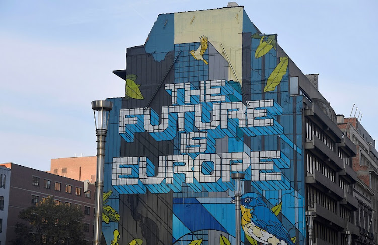 A wall mural is seen near the EU Commission and Council buildings in Brussels.